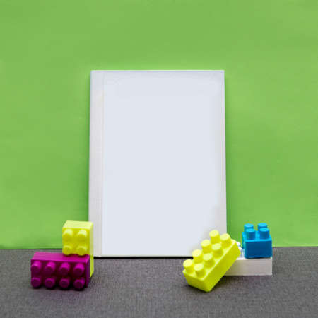 White postcard book with a green background 免版税图像