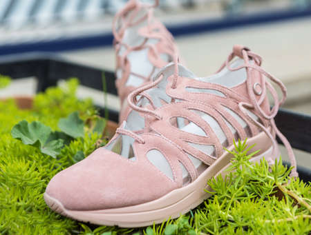 Woman pink sneakers shoes close up