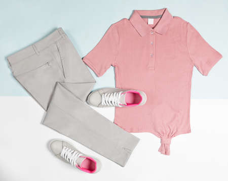 Men's casual outfits for man clothing set with pink t-shirt, gray shoes, pants isolated on a white background, top view