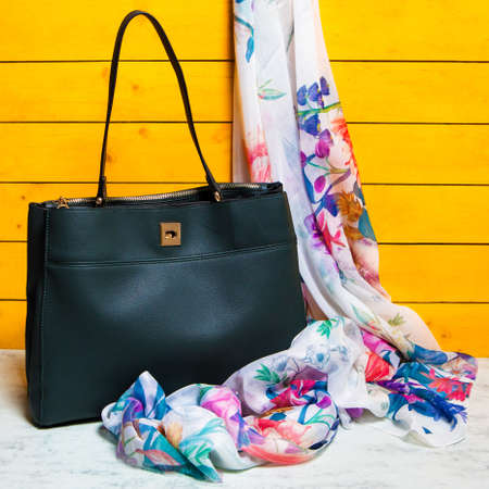 Black woman handbag with a scarf isolated