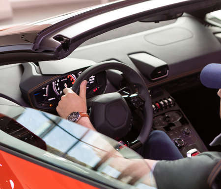 Man driving a cabriolet sports car close up 免版税图像 - 156135520