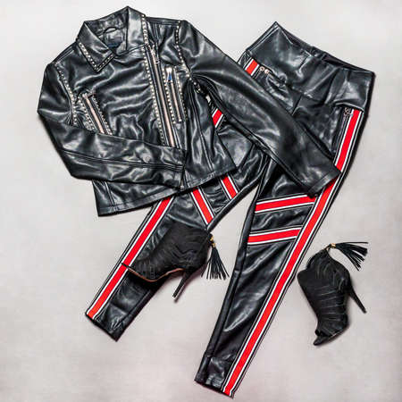 Black and red leather woman jacket pant and shoe isolated 免版税图像