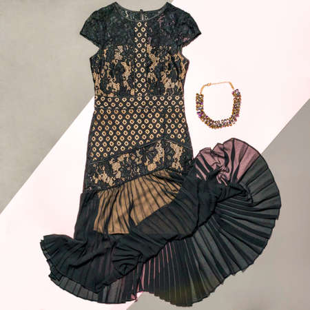 Black lace patterned bouquet dress with a necklace isolated 免版税图像 - 156197771