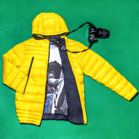 Yellow man jacket with a camera decor isolated