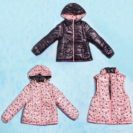 Pink and black girl jacket with hood isolated 免版税图像 - 156253231