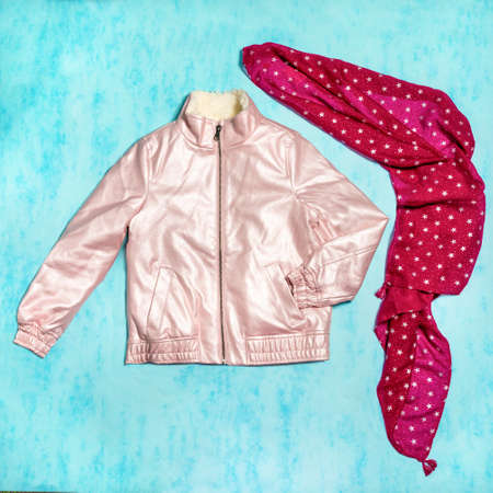 Pink woman jacket with a red scarf isolated