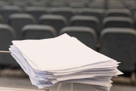 A4 paper documents in the event hall