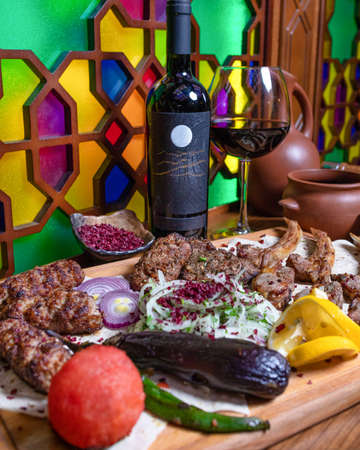 Lyulya kebab, sheep meat meal with wine bottle and glass