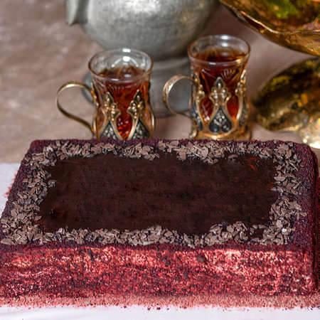 Arabic glass and red cake close up