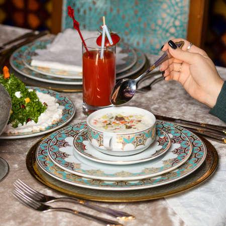 Woman eating yogurt based meal at the restaurant 免版税图像