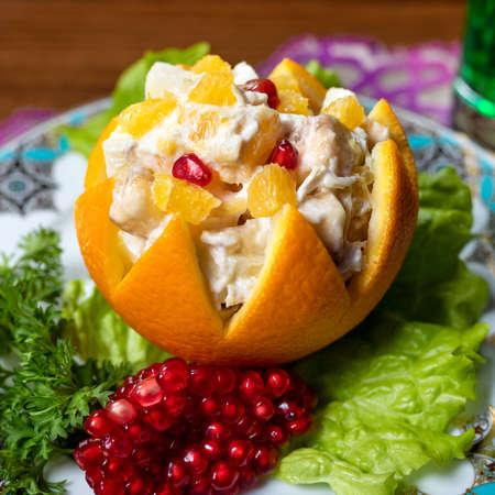 Orange snack with pomegranate close up 免版税图像