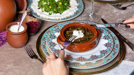 Woman eating Dolma, Azerbaijani meal top view 免版税图像