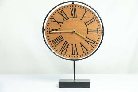 Wood table clock isolated white background