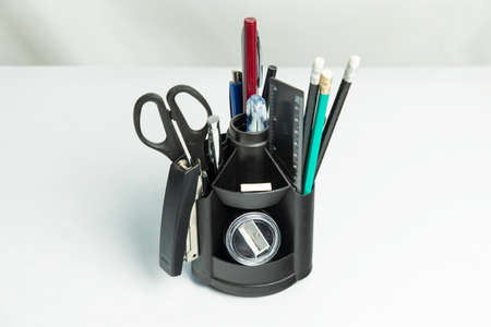 Black pencil tool holder table desk organizer isolated on white