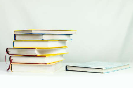 Books on the table white background, copy space