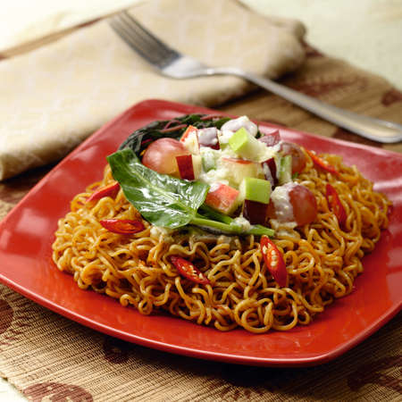 Instant Noodles Fried & Soup with Vegetables, Green Chili, Carrots, Broccoli, Lime etc. Stock Photo