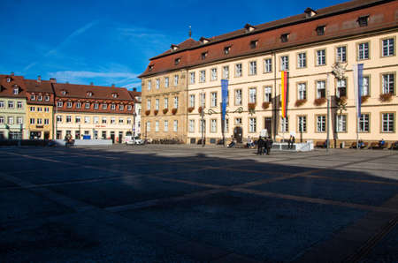 View of the sunlit facade of the town hall on Maxplatz in the World Heritage city of Bamberg. High quality photo. Copy space for characters or letters.