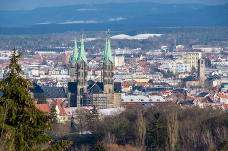 Skyline of city of Bamberg with the famous Cathedral in the foreground on a sunny winter day