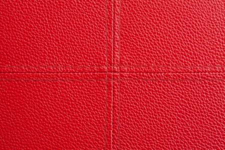 Red leather with cross sewing background, close-up from stool Stock Photo