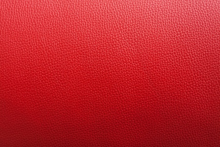 black leather texture: Red leather background with rough surface, this photo close up form stool Stock Photo