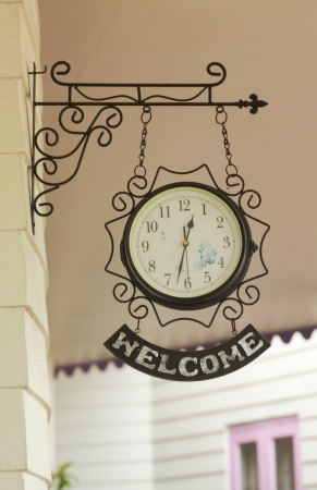 Welcome clock, vintage style, hanging on the wall photo