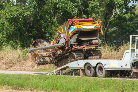 A tractor preparing to harvest the crops, north of Thailand photo