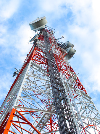 telco: High microwave mobile pole station with blue sky, telecommunication industry