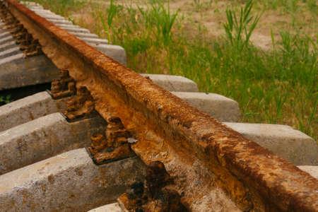 sleepers: Rusty rails on concrete sleepers Stock Photo