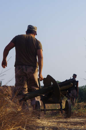gunner: A soldier with a machine gun Maxim