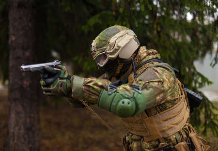 Ukraine soldier aiming a gun in the hands of the national guard 写真素材