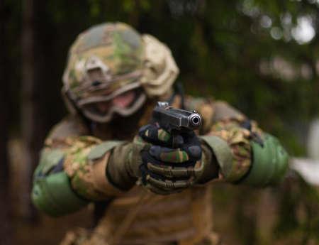 modern Ukraine soldier shoots a gun in his hands 写真素材