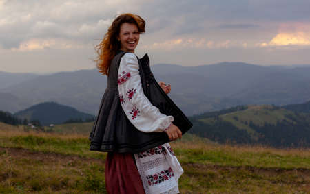 attractive girl in Ukrainian embroidery high in the carpathian mountains
