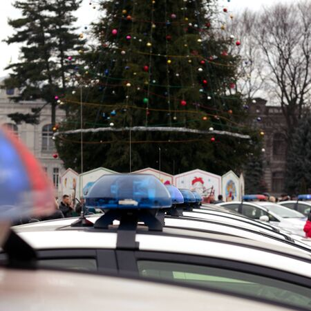 sirens: Row of police cars, with blue and red flashing sirens, Ukraine. selective focus
