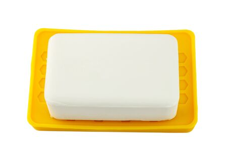 antibacterial soap: White soap on yellow holder isolated on white background