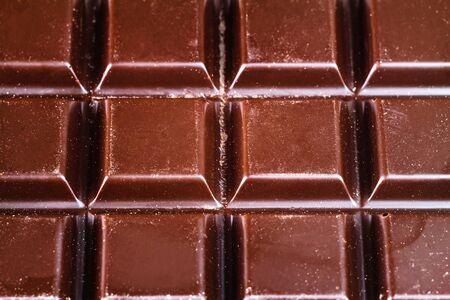 bar top: Tasty dark chocolate bar, top view,  close-up