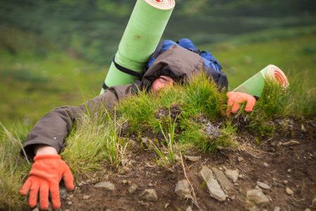Hiker, men climbing a top mountain, emotion of joy on his face, Carpathian, Ukraine.