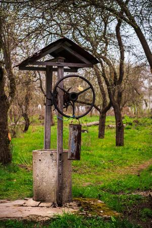 neglected: Old, neglected well in garden of Ukrainian village
