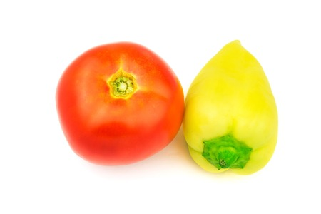 Fresh tomato and yellow bell pepper isolated on white background.