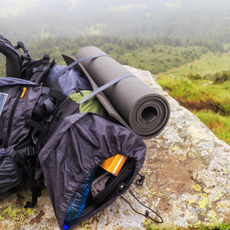 packsack: Tourist backpack on the stone at mountain top, Carpathian, Ukraine