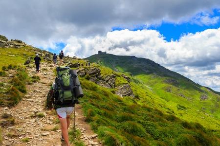 Group of tourists hiking in Carpathian mountains, nature landscape, Chornogora ridge, Ukraine