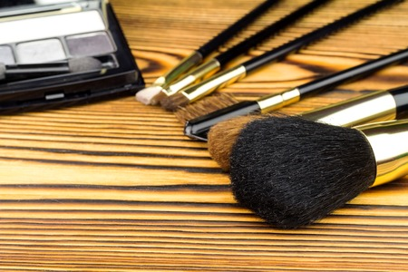 basic care: Professional cosmetic brushes for makeup on wooden background Stock Photo