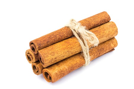 Group of cinnamon sticks isolated on white background, close-up