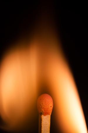 Burning match isolated on a black background, macro image Stock Photo