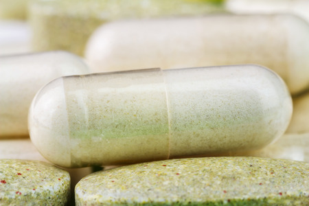 nutritional therapy: Mixed natural food supplement pills, multivitamin and glucosamine capsules, macro image