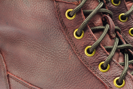 close-up view of lacing on brown leather boot Stock Photo