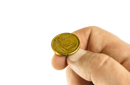 Golden euro cent on hand fingers, tossing coin, heads or tails game, isolated on white background Imagens