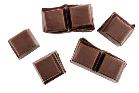 Chocolate cubes, pieces of bitter, dark chocolate bar, isolated on white background, top view. Stock Photo
