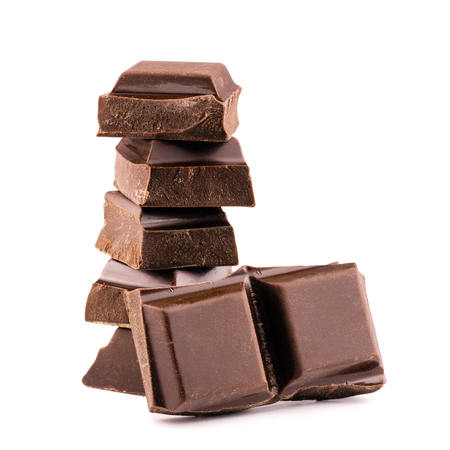 Chocolate cubes on heap, pieces of bitter, dark chocolate bar, isolated on white background, side view. Фото со стока