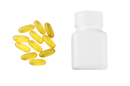 Yellow capsules omega 3, fatty acid, fish oil and bottle, container isolated on white background, top view.