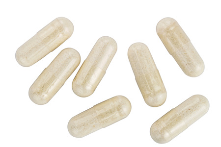 Capsules of glucosamine chondroitin, healthy supplement pills isolated on white background, top view.